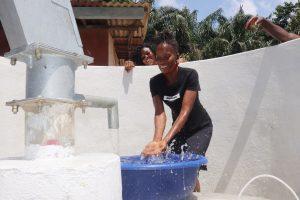 The Water Project:  Woman Joyfully Splashing Clean Water