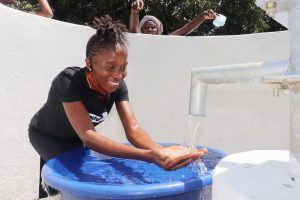 The Water Project:  Woman Rejoicing For Clean Water Flowing