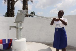 The Water Project:  Student Happy Collecting Water