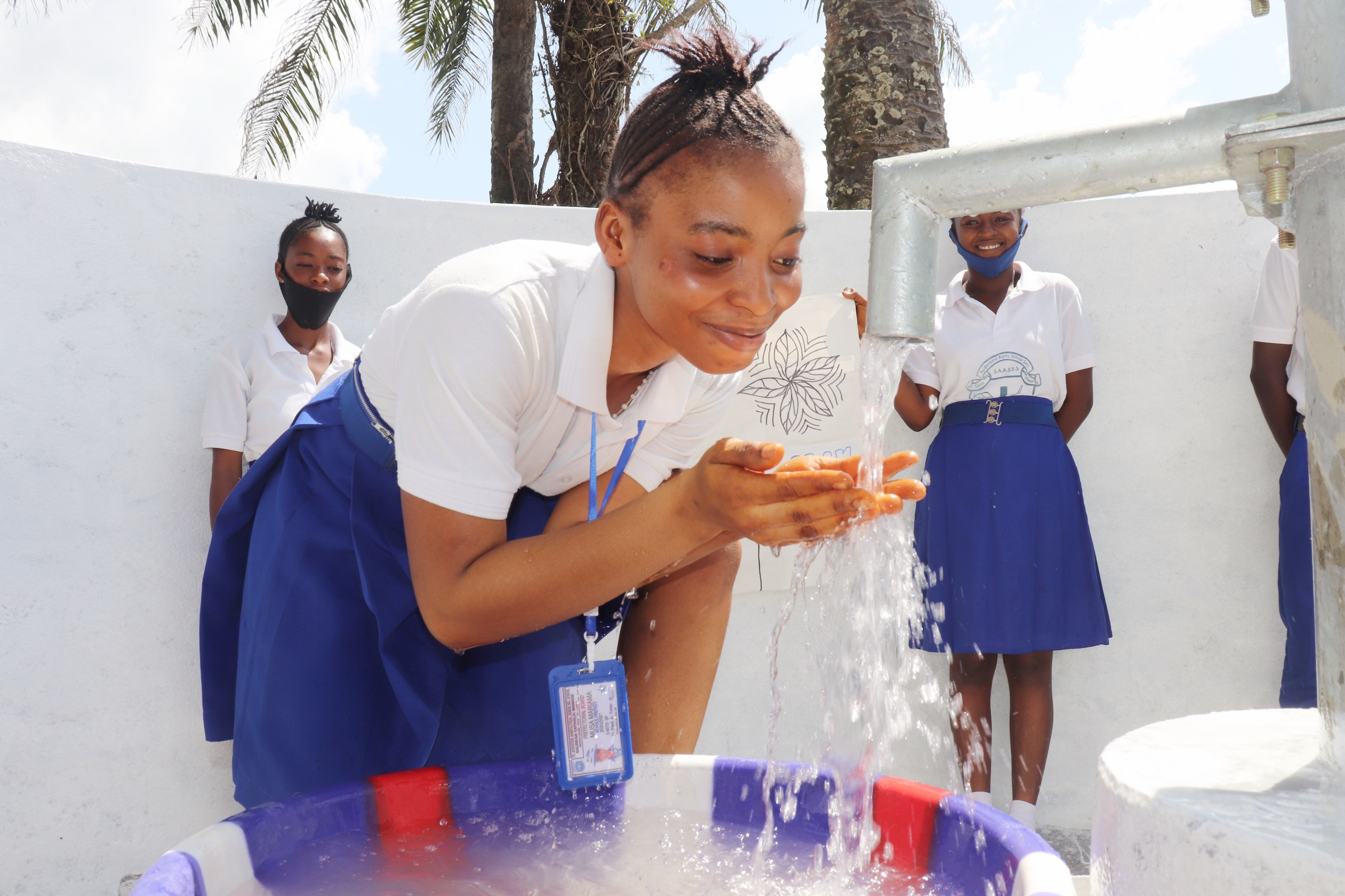 The Water Project : sierraleone20432-students-joyfully-playing-and-looking-at-clean-water