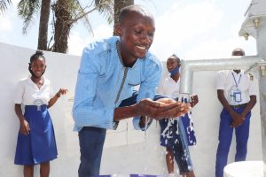 The Water Project:  Teacher Joyfully Playing With Clean Water