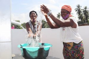The Water Project:  Community Members Celebrating And Splashing Water
