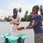 The Water Project: Lokomasama, Conteya Village -  Community Members Celebrating And Splashing Clean And Safe Drinking Water