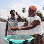 The Water Project: Lokomasama, Conteya Village -  Community Member Joyfully Looking At Safe Drinking Water Flowing
