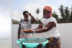 The Water Project:  Community Member Joyfully Looking At Safe Drinking Water Flowing