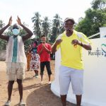 The Water Project: Lokomasama, Conteya Village -  Councilor Paul Dixion Celebrates With The Community
