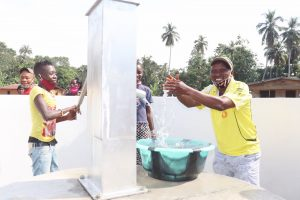 The Water Project:  Councilor Paul Dixion Rejoicing And Splashing Safe Drinking Water