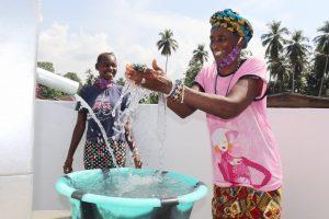 The Water Project:  Woman Joyfully Splashing Water