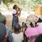 The Water Project: Lokomasama, Conteya Village -  Hygiene Facilitator Teaches About Diarrhea