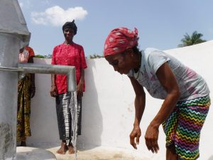 The Water Project:  Community Members Looking At Clean Water Flowing