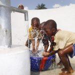 The Water Project: Lokomasama, Rotain Village -  Kids Splashing Clean Water