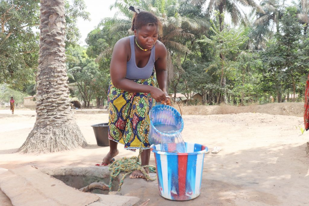 The Water Project : sierraleone21524-woman-collecting-water-3