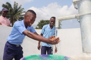 The Water Project:  Student Joyfully Looking At Clean Water Flowing