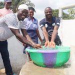The Water Project: Sulaiman Memorial Academy Jr. Secondary School -  Teachers Splashing Water