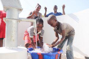 The Water Project:  Kids Happy Splashing Water
