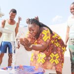 The Water Project: Lungi, Suctarr, #3 Lovell Lane -  Woman Joyfully Splashing Clean And Safe Drinking Water