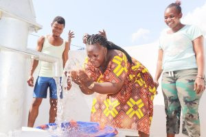 The Water Project:  Woman Joyfully Splashing Clean And Safe Drinking Water
