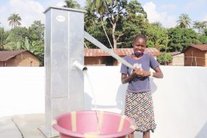 The Water Project:  Community Member Joyfully Collecting Water