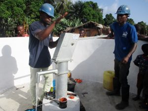The Water Project:  Maintenance Officer Collects Water After Installation