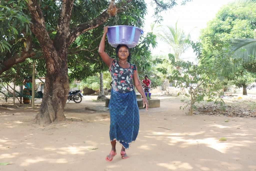 The Water Project : sierraleone21522-community-member-carrying-water-4