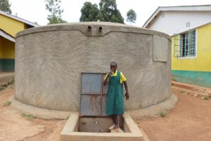 The Water Project:  Velma Taking A Drink From The Rain Tank