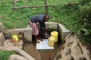 The Water Project:  Gloria Fetching A Drink