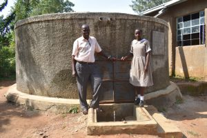 The Water Project:  Amisa And A Teacher At The Tank