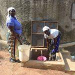 The Water Project: Ichinga Muslim Primary School -  The Kitchen Mamas Enjoying The Rain Tank Water For Work