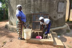 The Water Project:  The Kitchen Mamas Enjoying The Rain Tank Water For Work