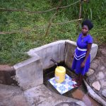 The Water Project: Emukoyani Community, Ombalasi Spring -  Mercyline Fetching Water
