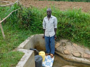 The Water Project:  Herbert Fetching Water