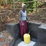 The Water Project: Musango Commnuity, Wabuti Spring -  Rosemary Collecting Water