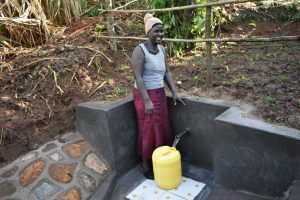 The Water Project:  Rosemary Collecting Water