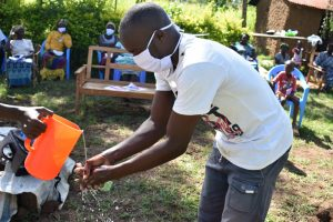 The Water Project:  Community Member Demonstrates Handwashing