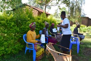 The Water Project:  Handing Out Covid Prevention Pamphlets