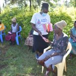 The Water Project: Musango Commnuity, Wabuti Spring -  Handing Out Training Workbooks And Pens