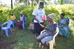The Water Project:  Handing Out Training Workbooks And Pens