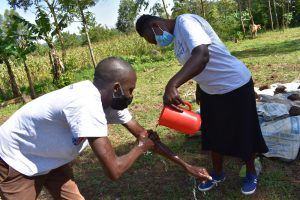 The Water Project:  Trainer Protus Demonstrates Handwashing Up To Elbows