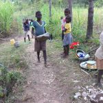 The Water Project: Luyeshe Community, Khausi Spring -  Children Deliver Stones To The Work Site