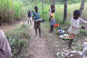 The Water Project:  Children Deliver Stones To The Work Site