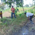 The Water Project: Makhwabuyu Community, Sayia Spring -  Taking Measurements For Fencing