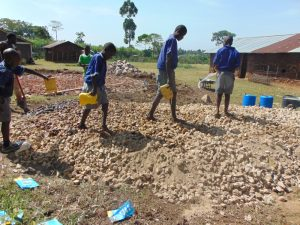 The Water Project:  Students Deliver Water To Mix Concrete