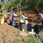 The Water Project: Maraba Community, Shisia Spring -  Field Officer Adelaide Hands Over Shisia Spring