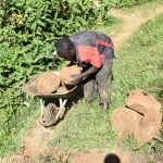 The Water Project: Maraba Community, Shisia Spring -  Delivering Large Stones To The Work Site