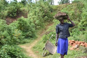 The Water Project:  Woman Carrying Grass To Plant At The Spring