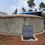 The Water Project: Friends Musiri Secondary School -  Complete Rain Tank With Water Flowing