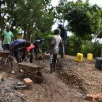 The Water Project: Friends Musiri Secondary School -  Many Hands Help Mix Concrete