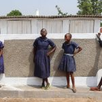 The Water Project: Mwikhupo Primary School -  Girls Pose At Their New Latrines