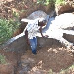 The Water Project: Maraba Community, Shisia Spring -  Reinforcing Headwall With Clay For Better Collection