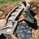 The Water Project: Maraba Community, Shisia Spring -  Placing The Tarp